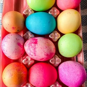 Dyed Easter eggs in egg tray
