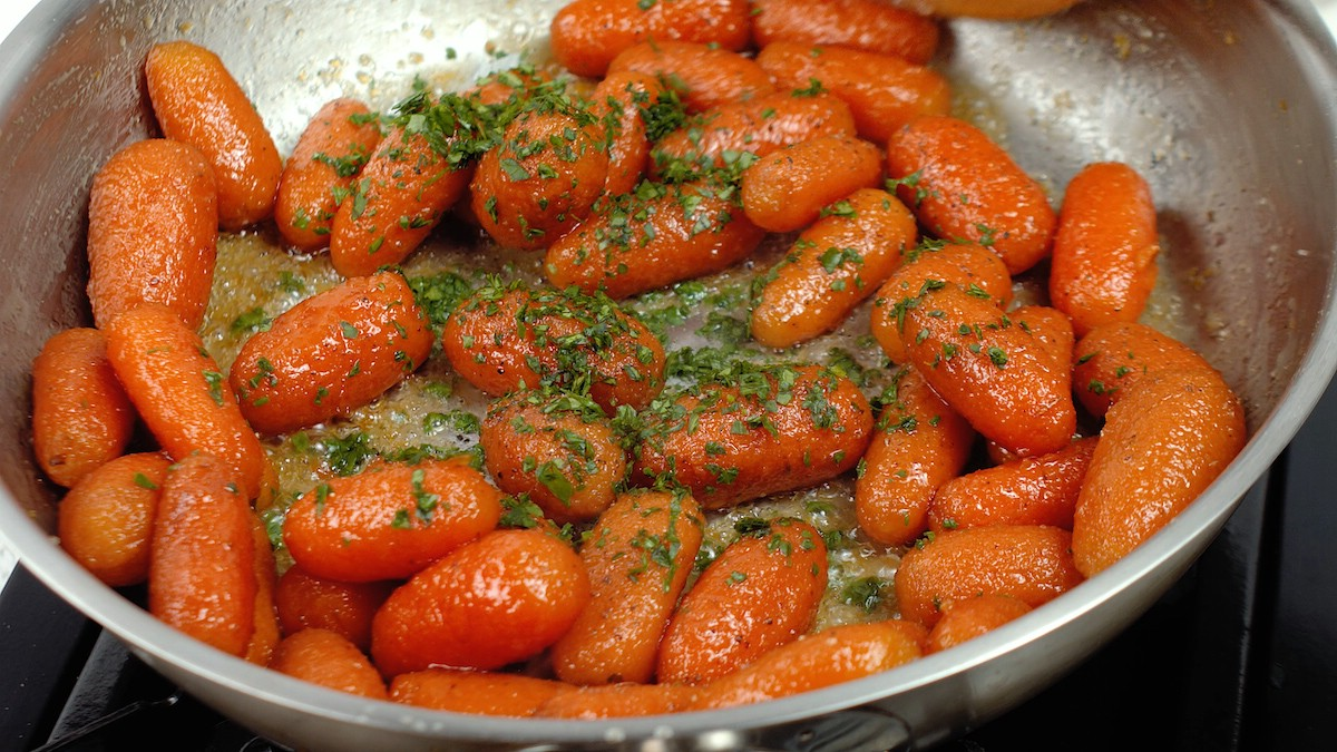 Carrots in skillet topped with parsley
