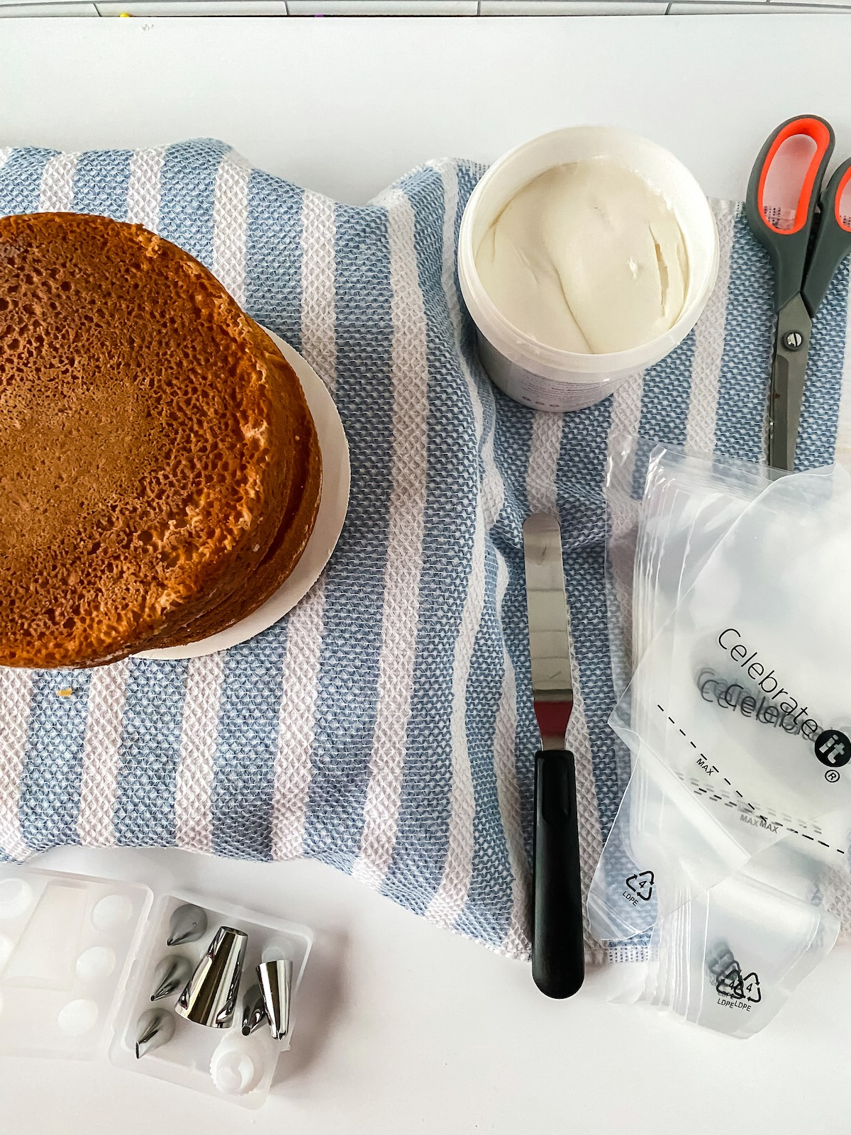 Supplies for layered cake with basket weave icing