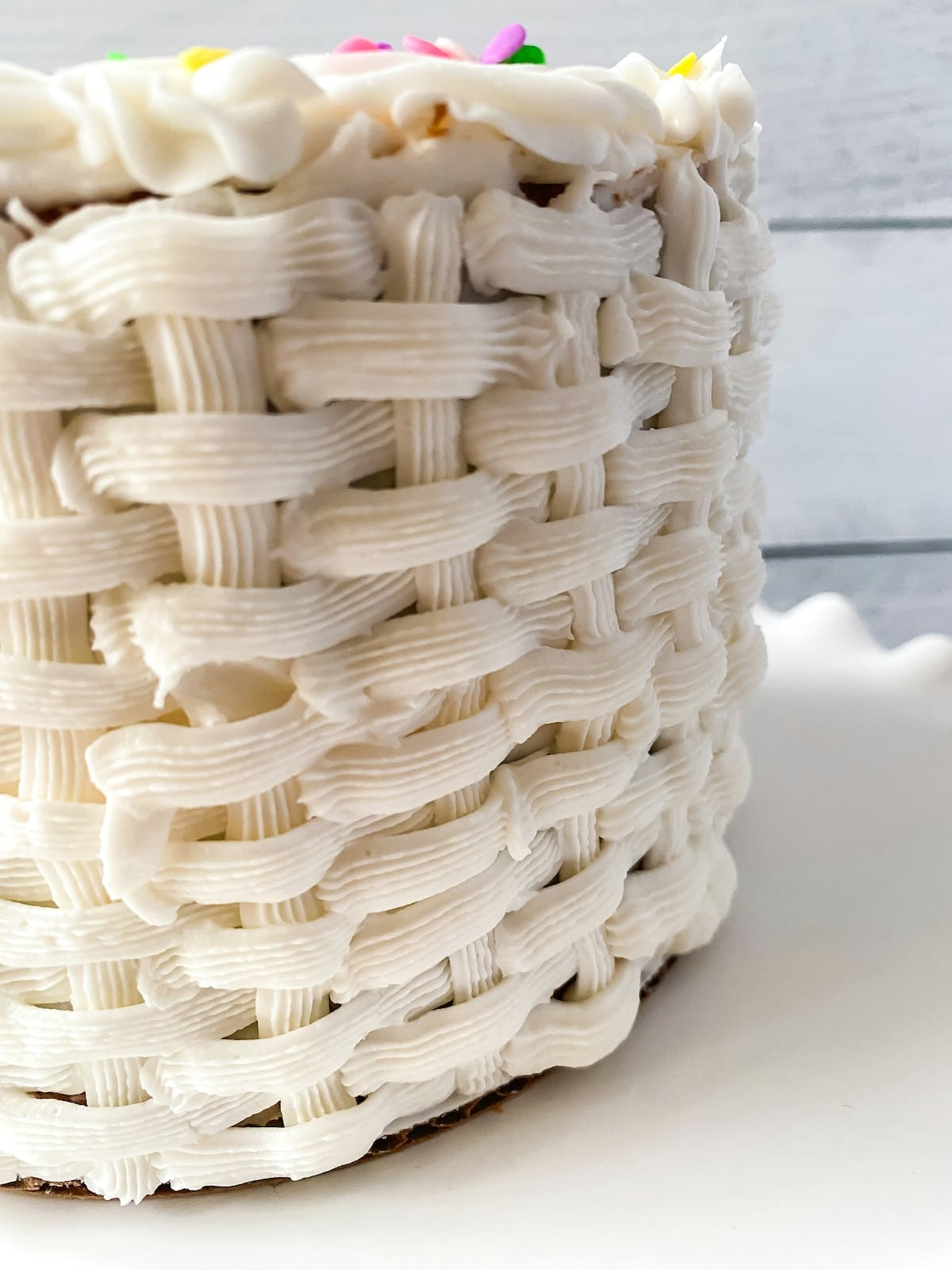 Close up of basket weave detail on iced cake