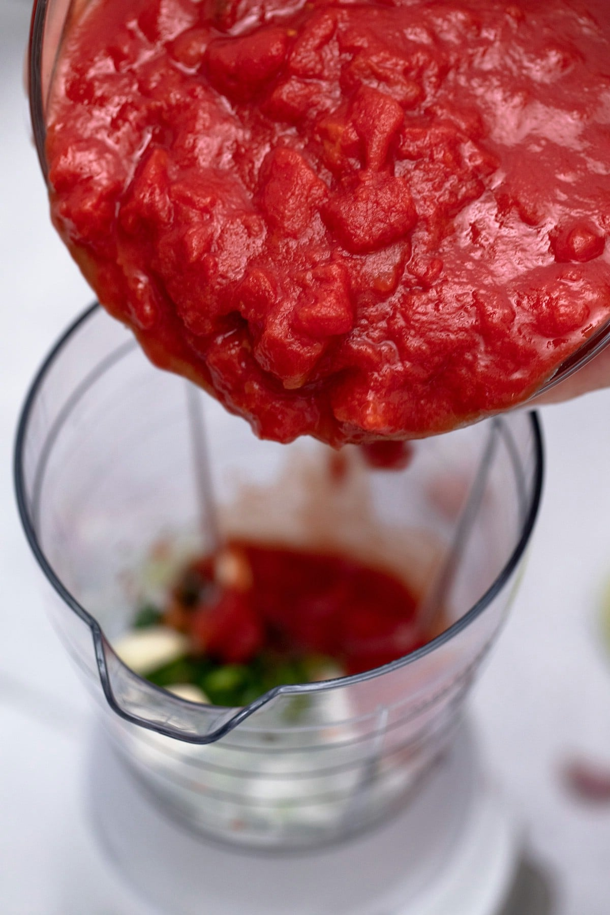 Pouring tomatoes into blender