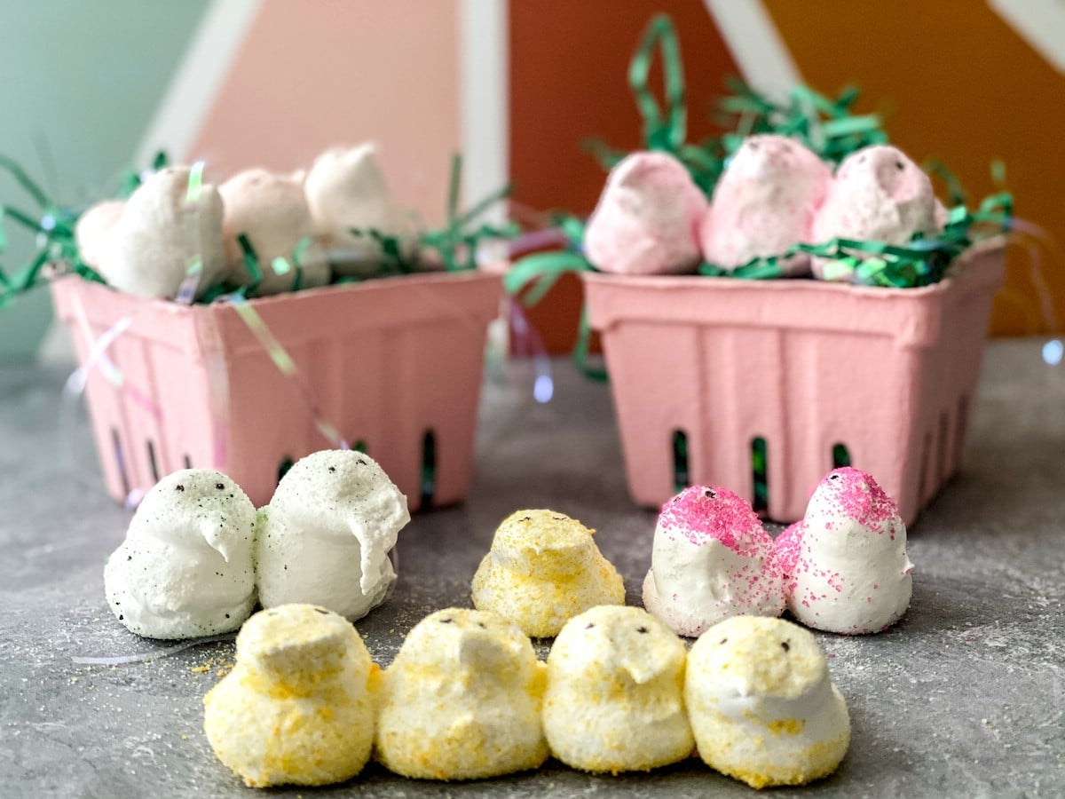Display of homemade marshmallow peeps in front of pink and green background