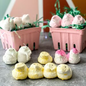 Homemade Peeps displayed on gray counter with mini Easter baskets