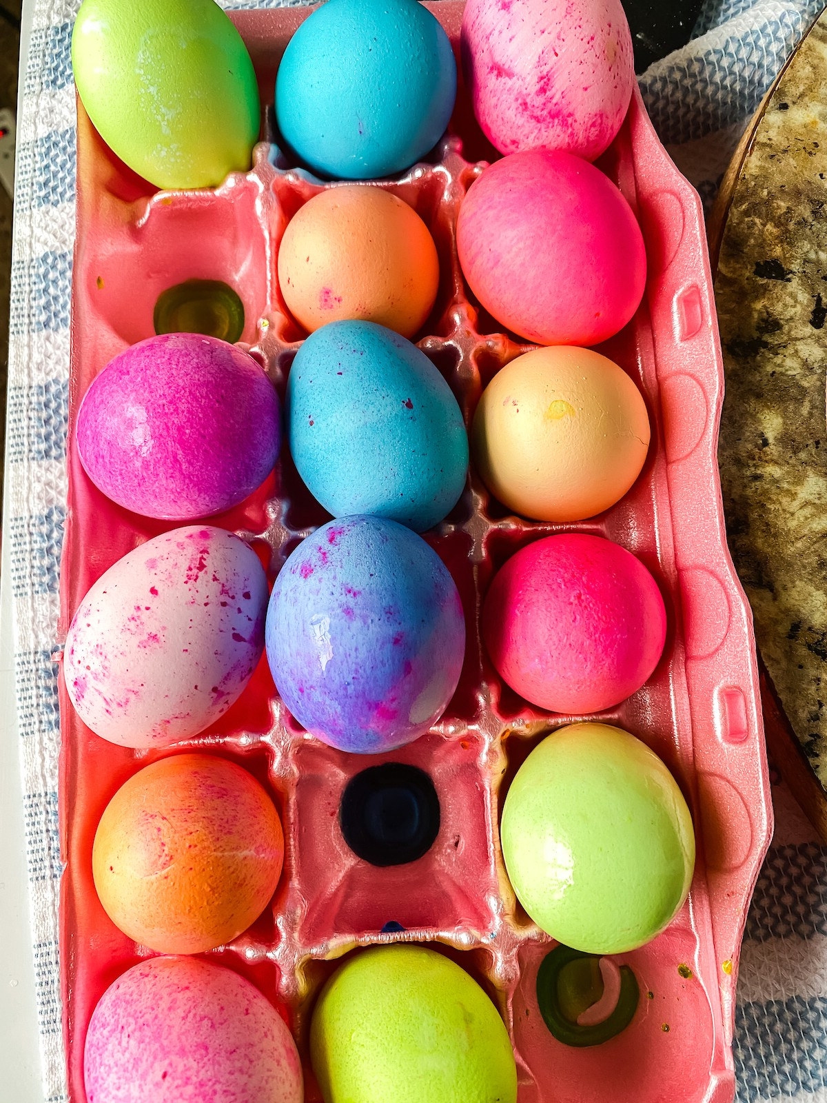 Dyed Easter eggs in pink egg carton