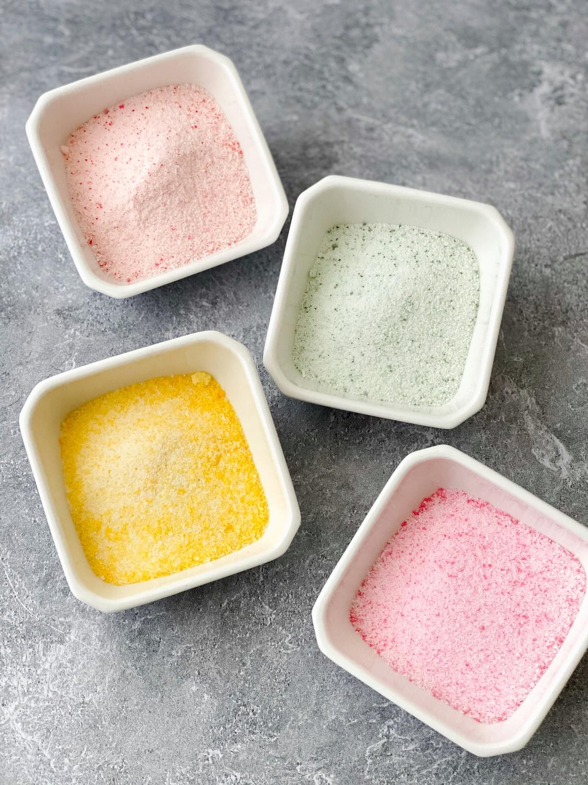 White bowls of pastel sugar