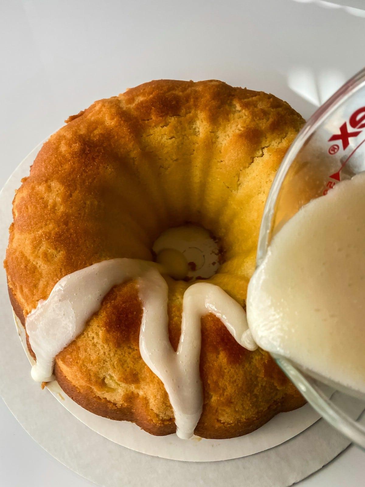 Pouring glaze over bundt cake