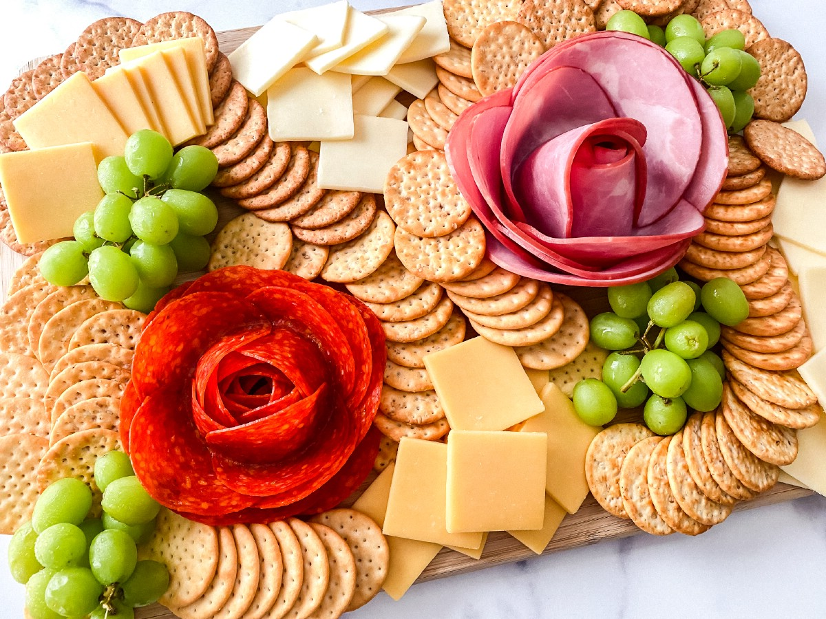 Full platter with crackers cheese fruit and meats