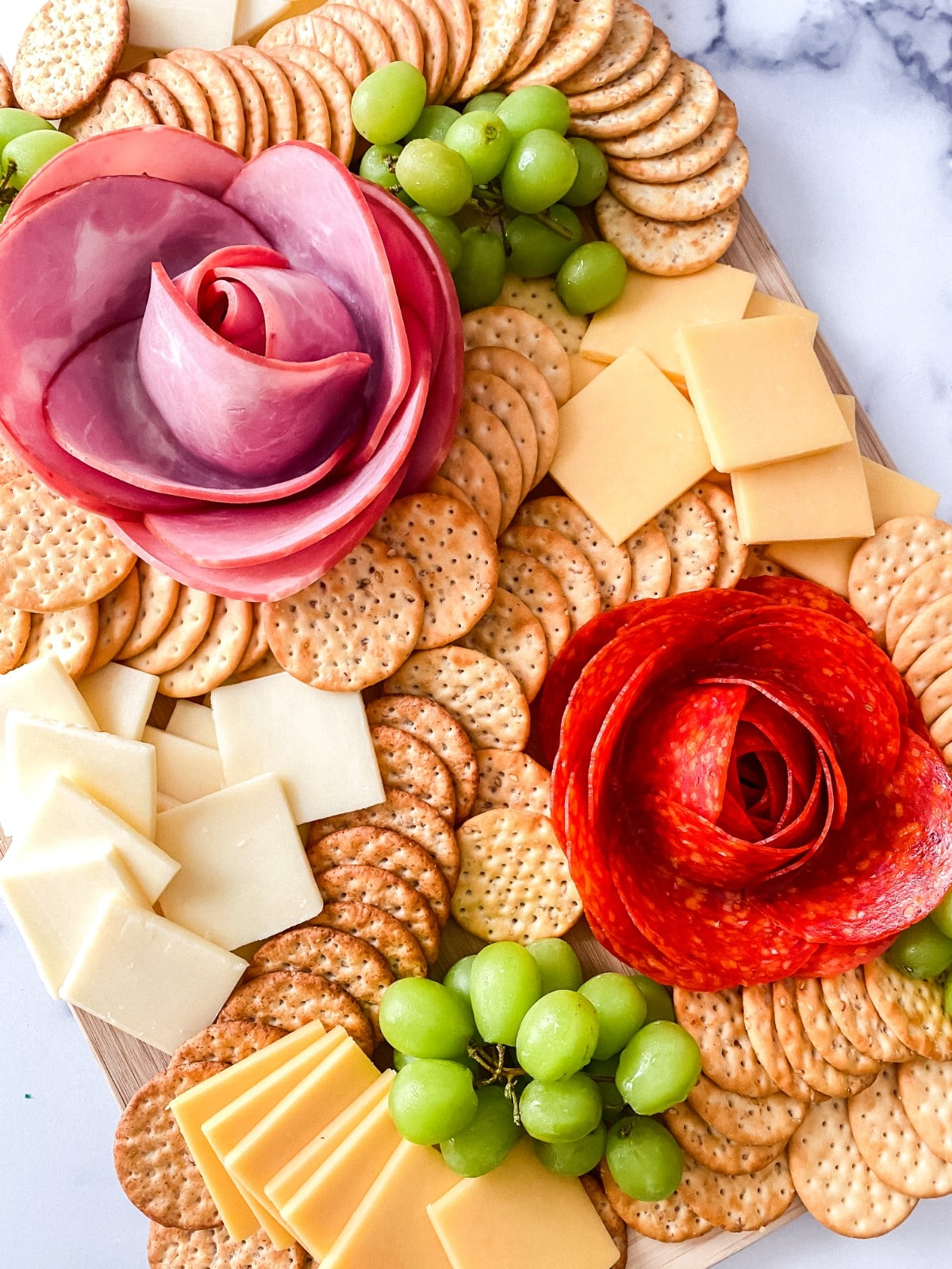 Grazing board with white and yellow cheese