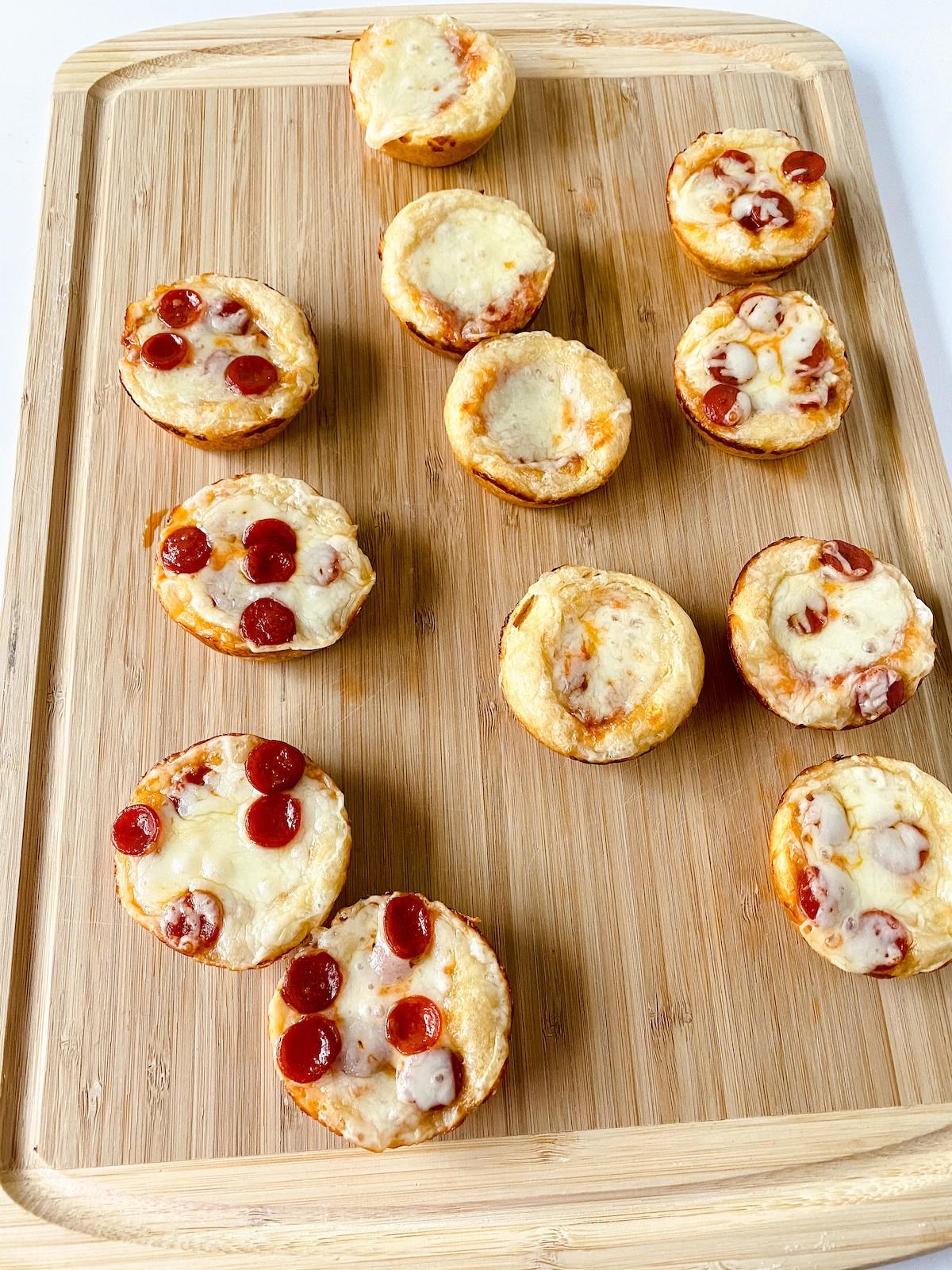 Mini pizzas on cutting board