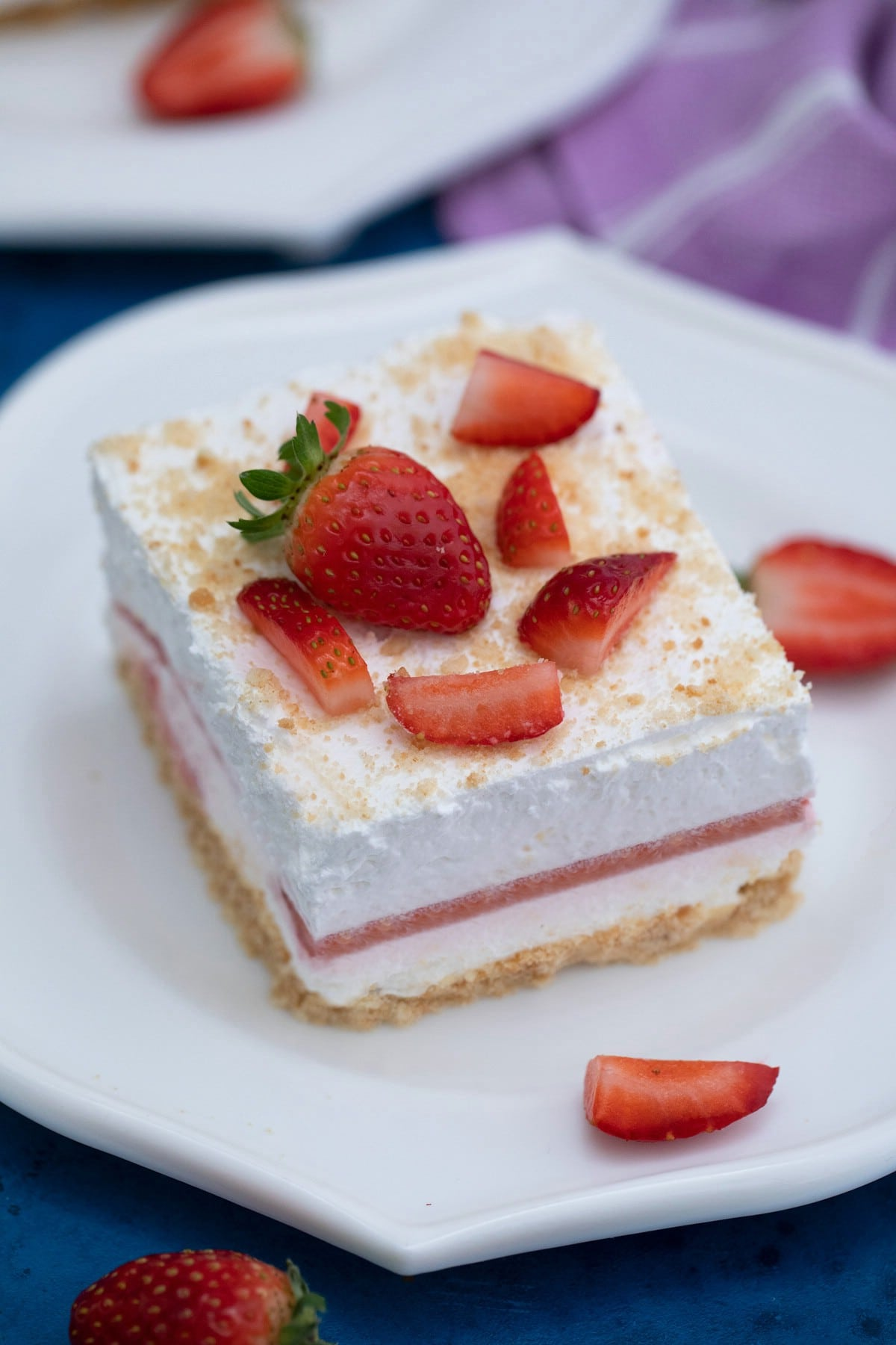 Strawberry topped cheesecake on plate