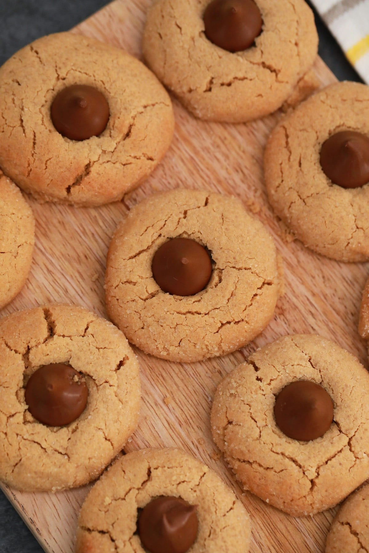 Cookies with hersheys kisses on wooden counter