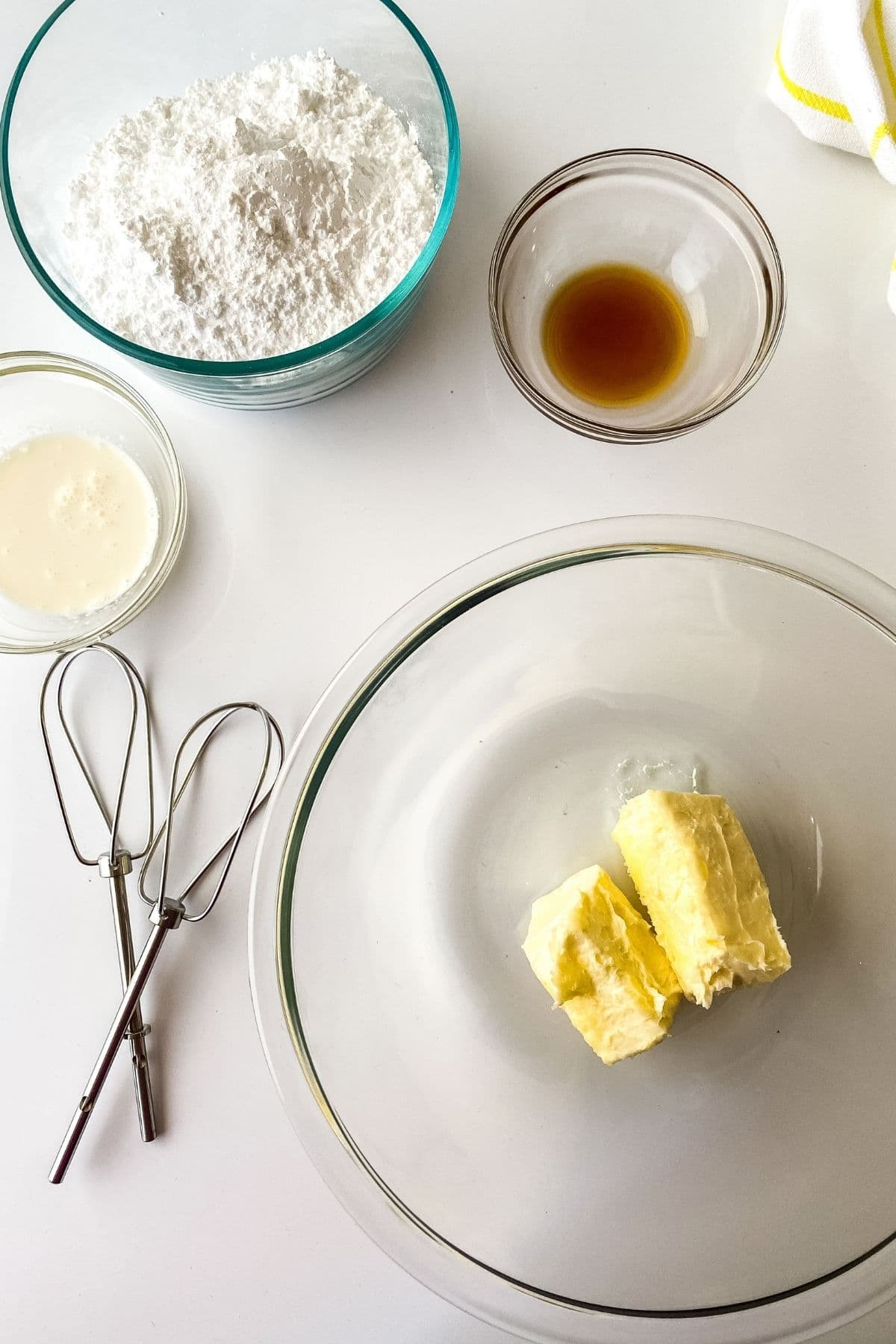 Ingredients for frosting in clear bowls