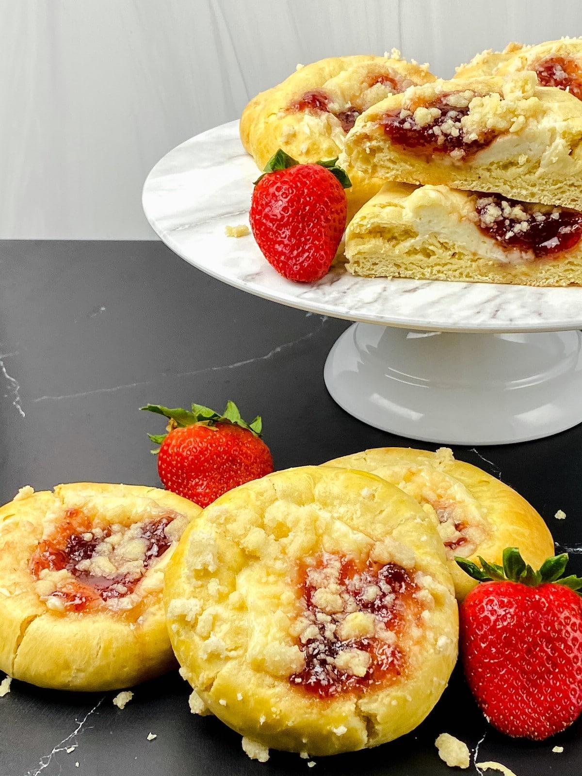 Strawberry cream cheese danish on white cake stand