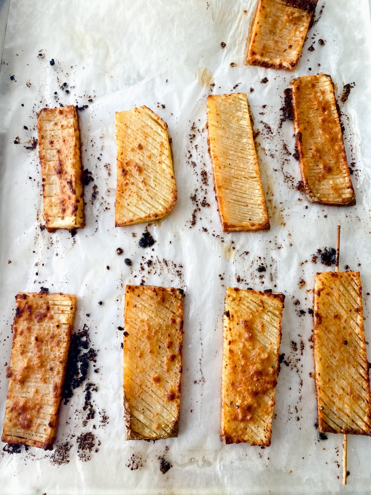 Browned potato slices on baking sheet