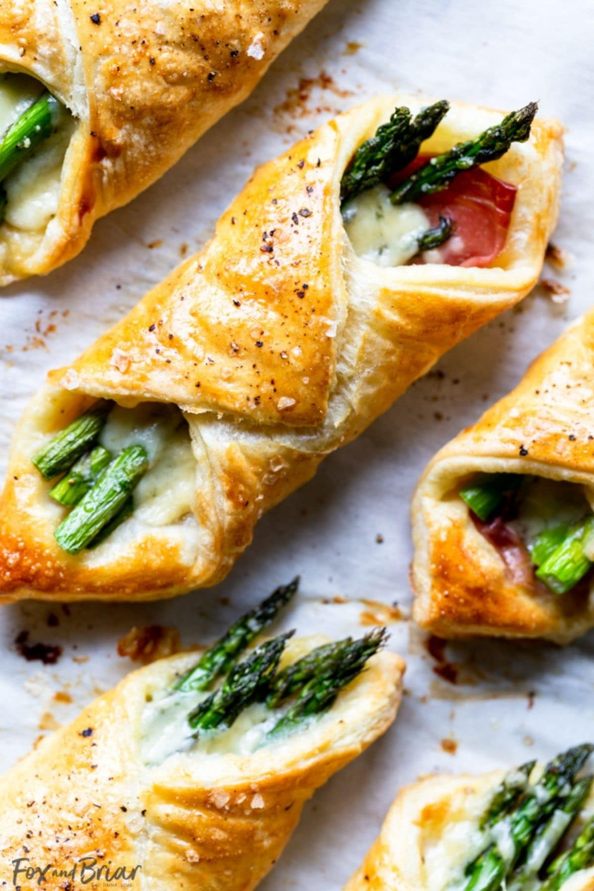 Pastry bundles filled with creamy sauce and asparagus