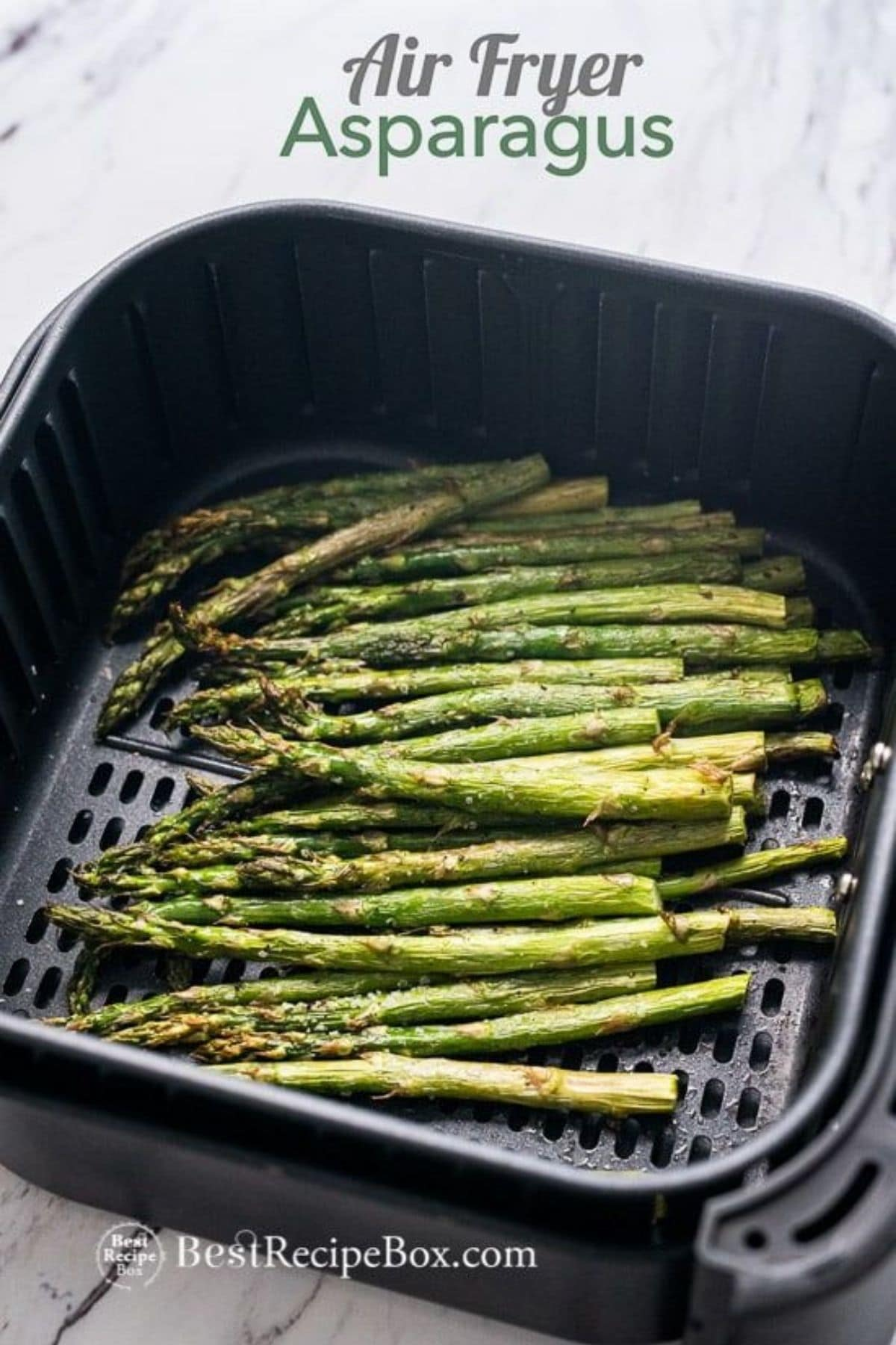 Layer of asparagus in an air fryer basket