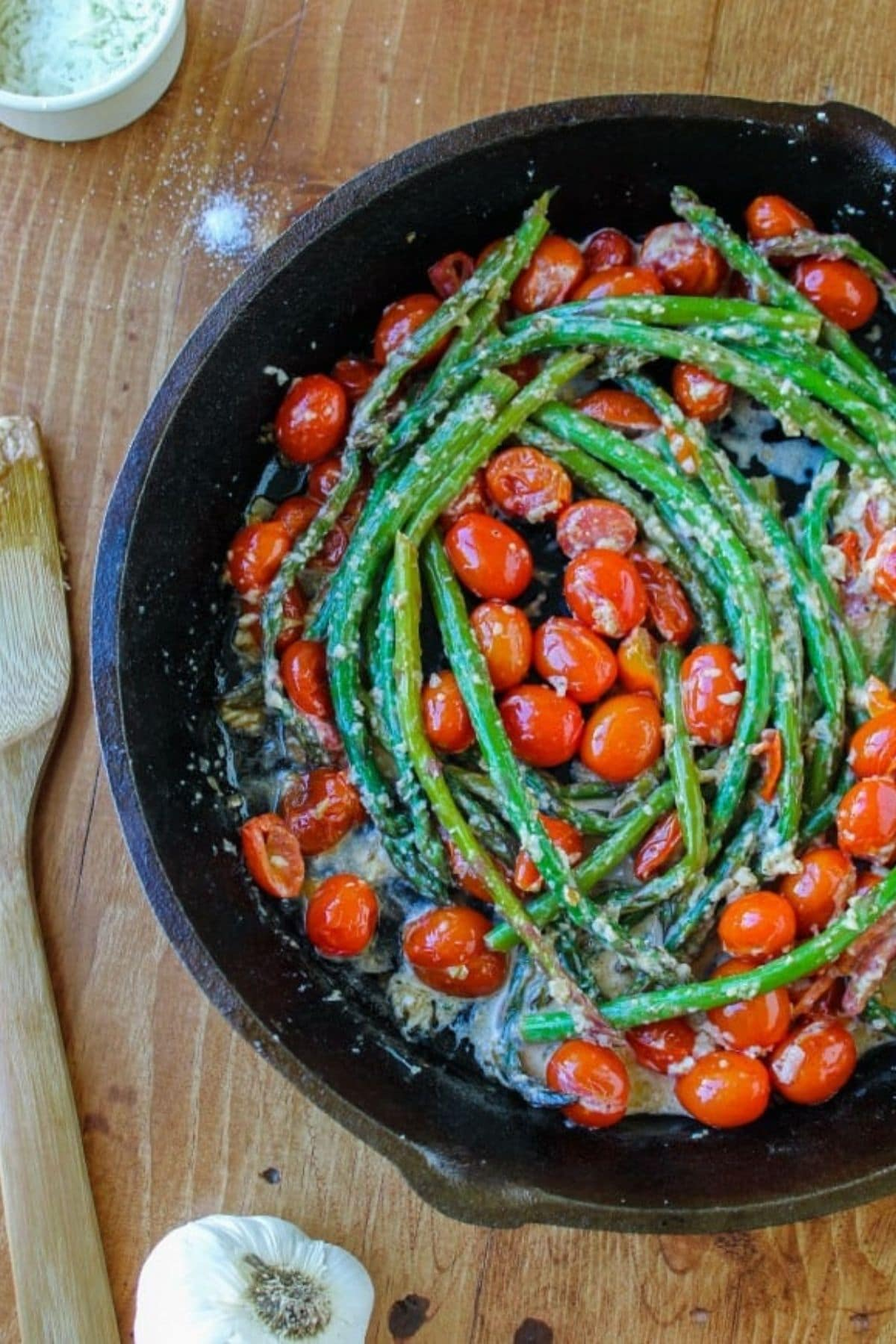 Cherry tomatoes and asparagus in cast iron skillet