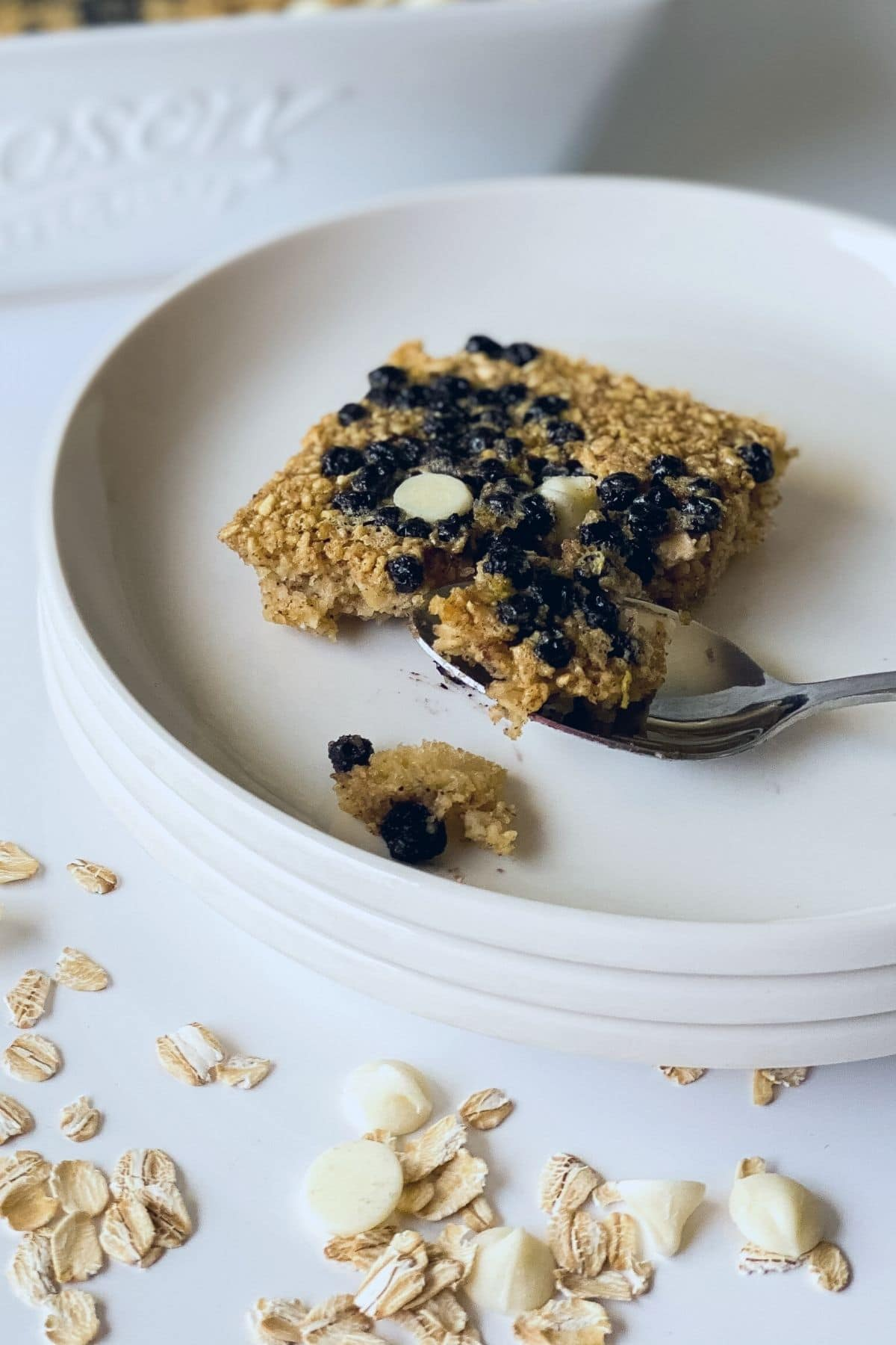 White plate with blueberry oat bar