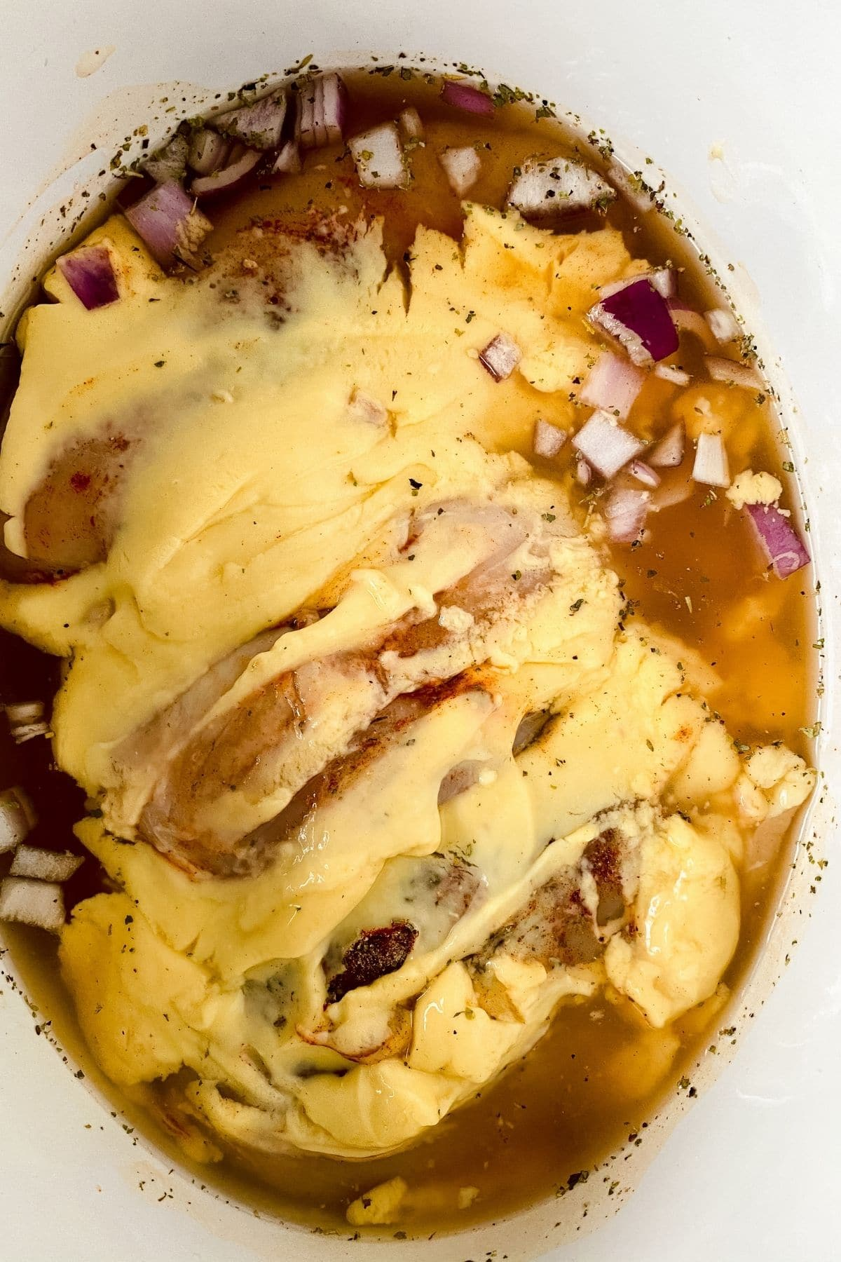 Chicken covered in cream soup