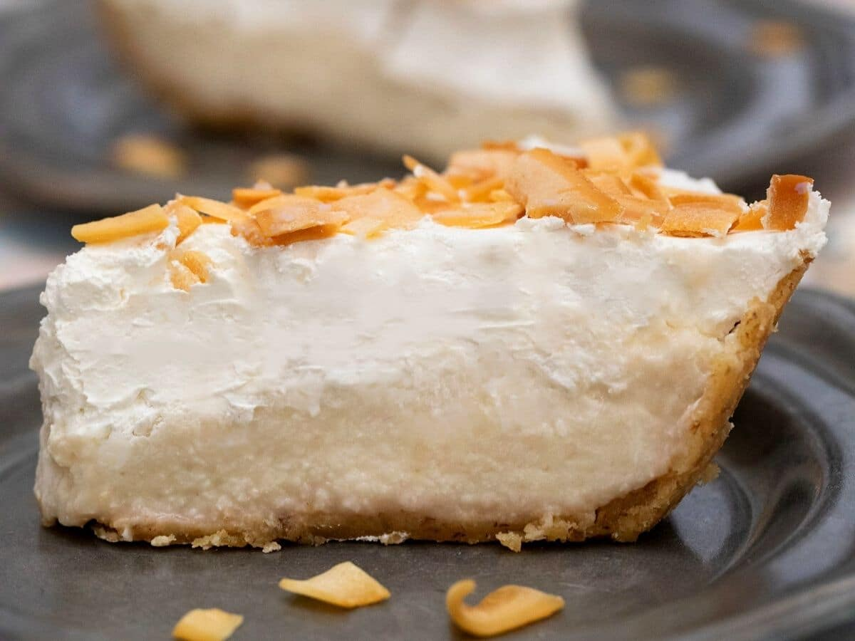 Side of sliced coconut pie