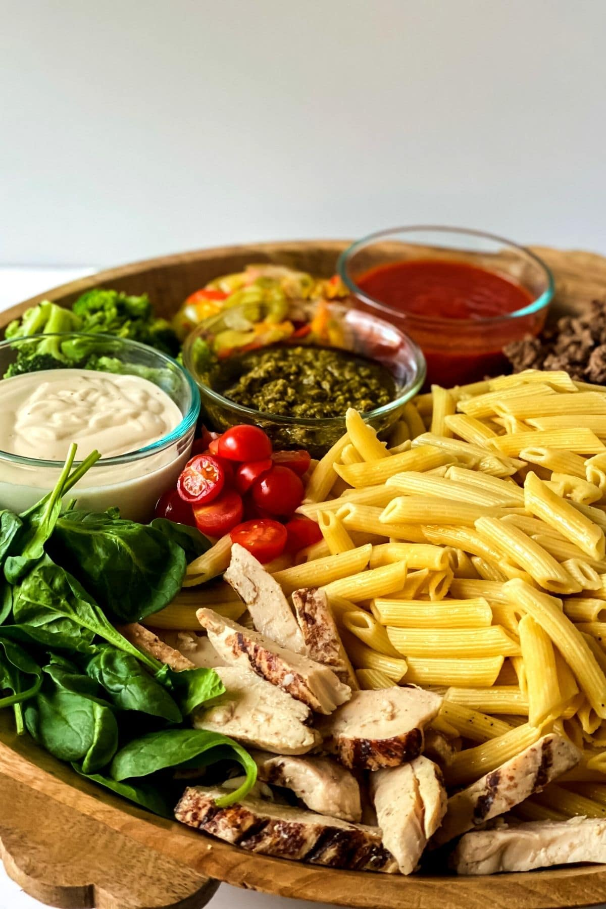 Charcuterie board with pasta and vegetables