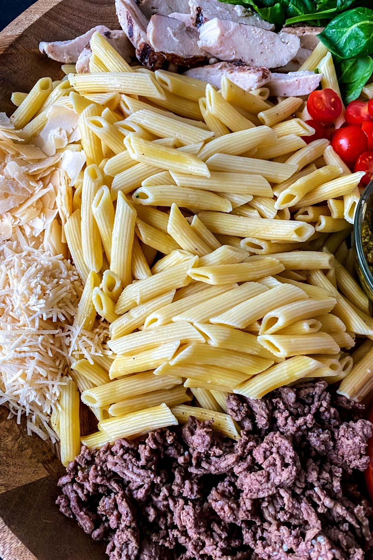 Close up of pasta and meats on tray