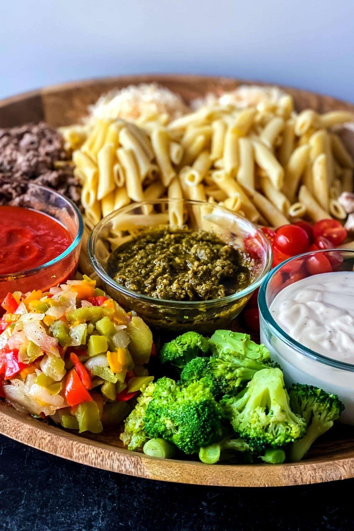 Charcuterie pasta board with veggies and broccoli