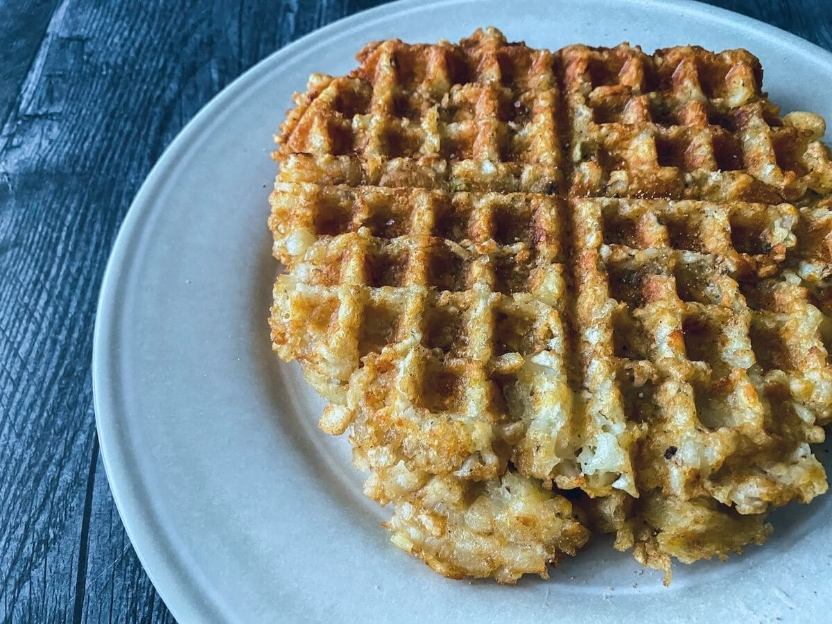 Tater tot waffle on blue plate