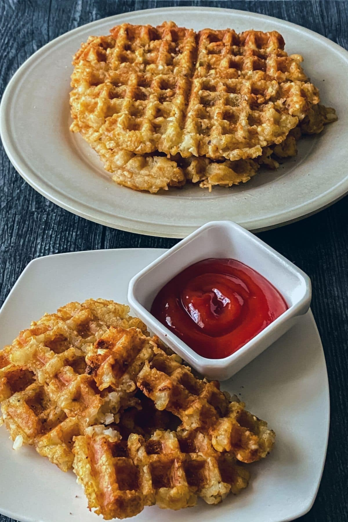 Tater tot waffle sticks on saucer by bowl of sauce