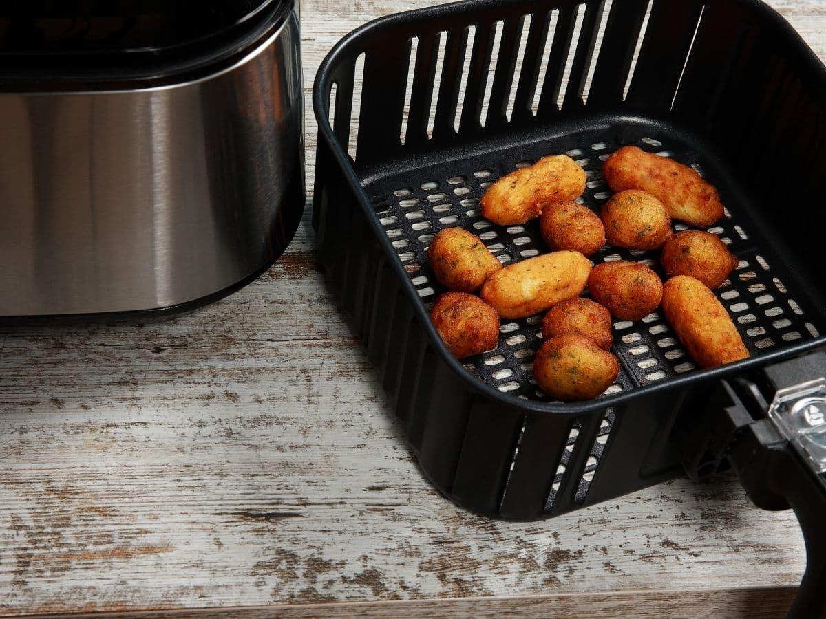 Hush puppies in black square air fryer basket