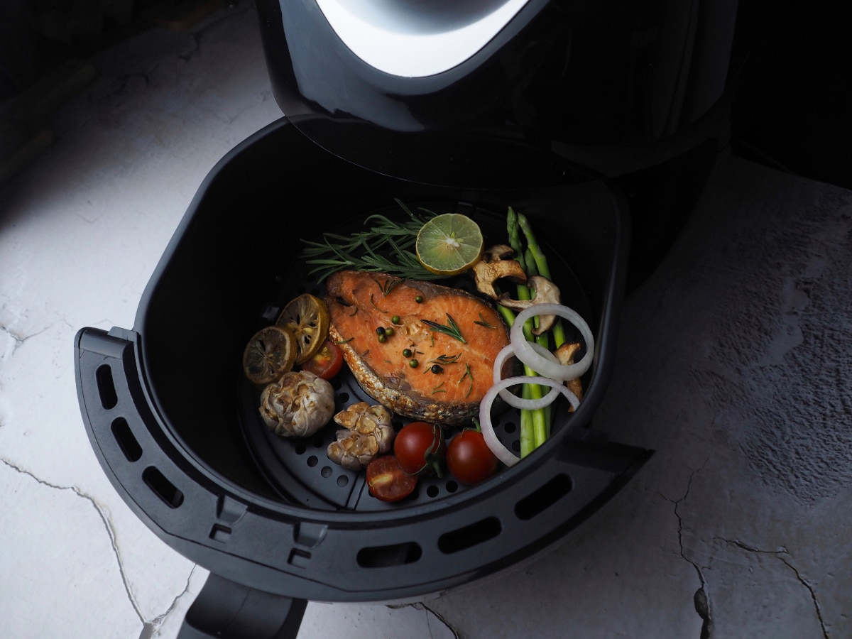 Salmon and vegetables in air fryer basket