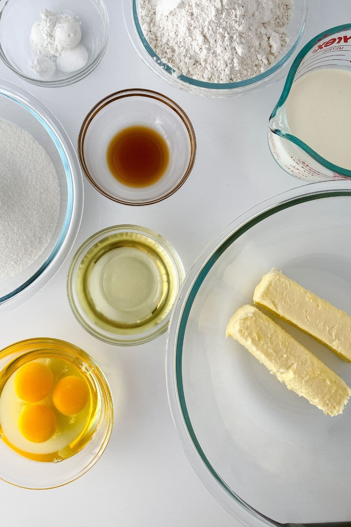 Ingredients for vanilla cake in glass bowls