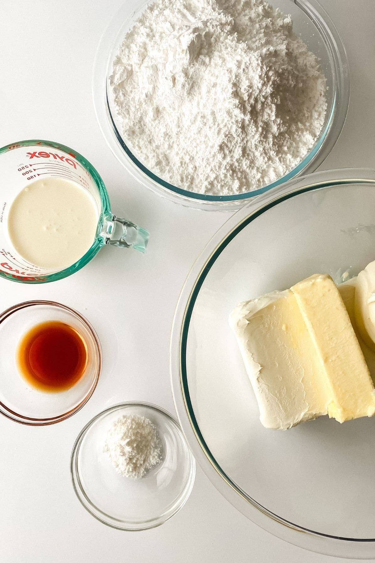 Ingredients for buttercream in glass bowls