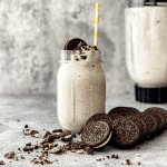 McFlurry in mason jar with Oreo crumbs and cookies beside it