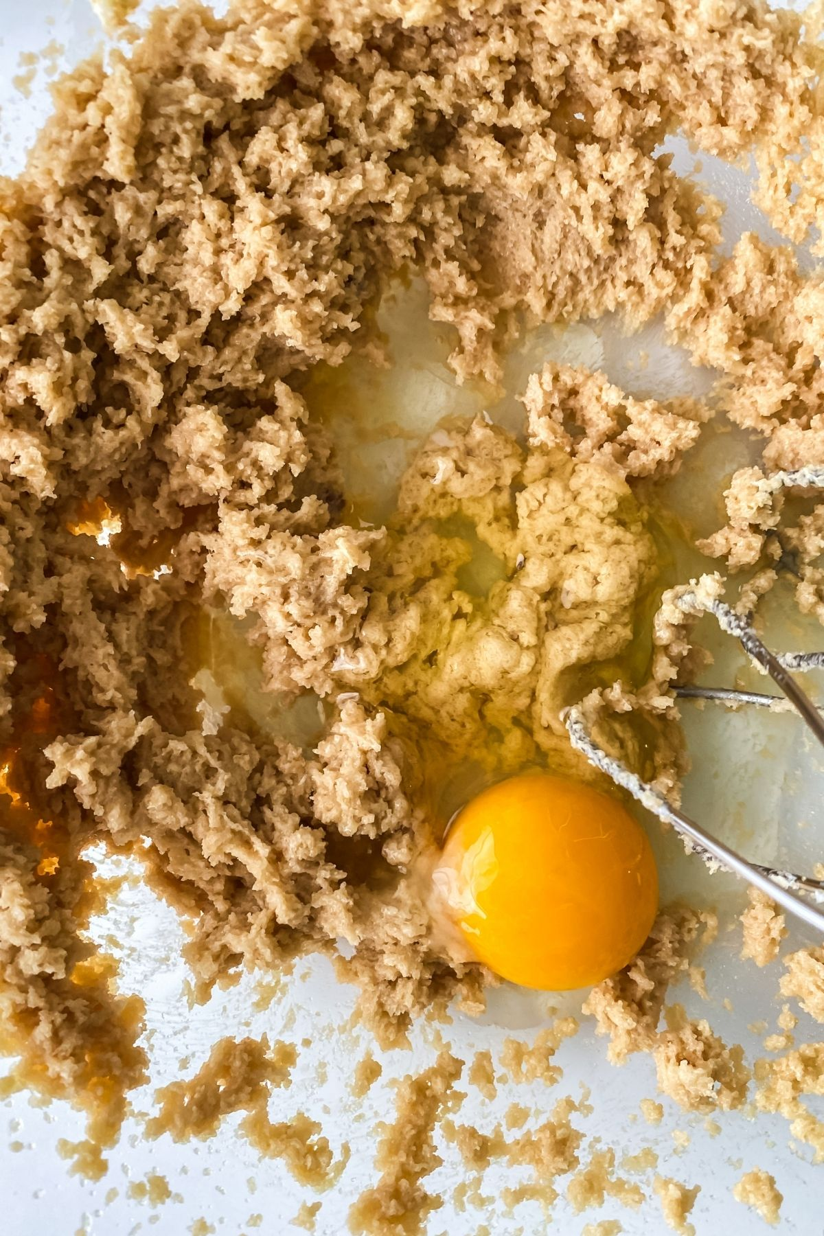 Adding eggs to creamed butter and sugar