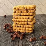 Stack of cut out cookies on black table