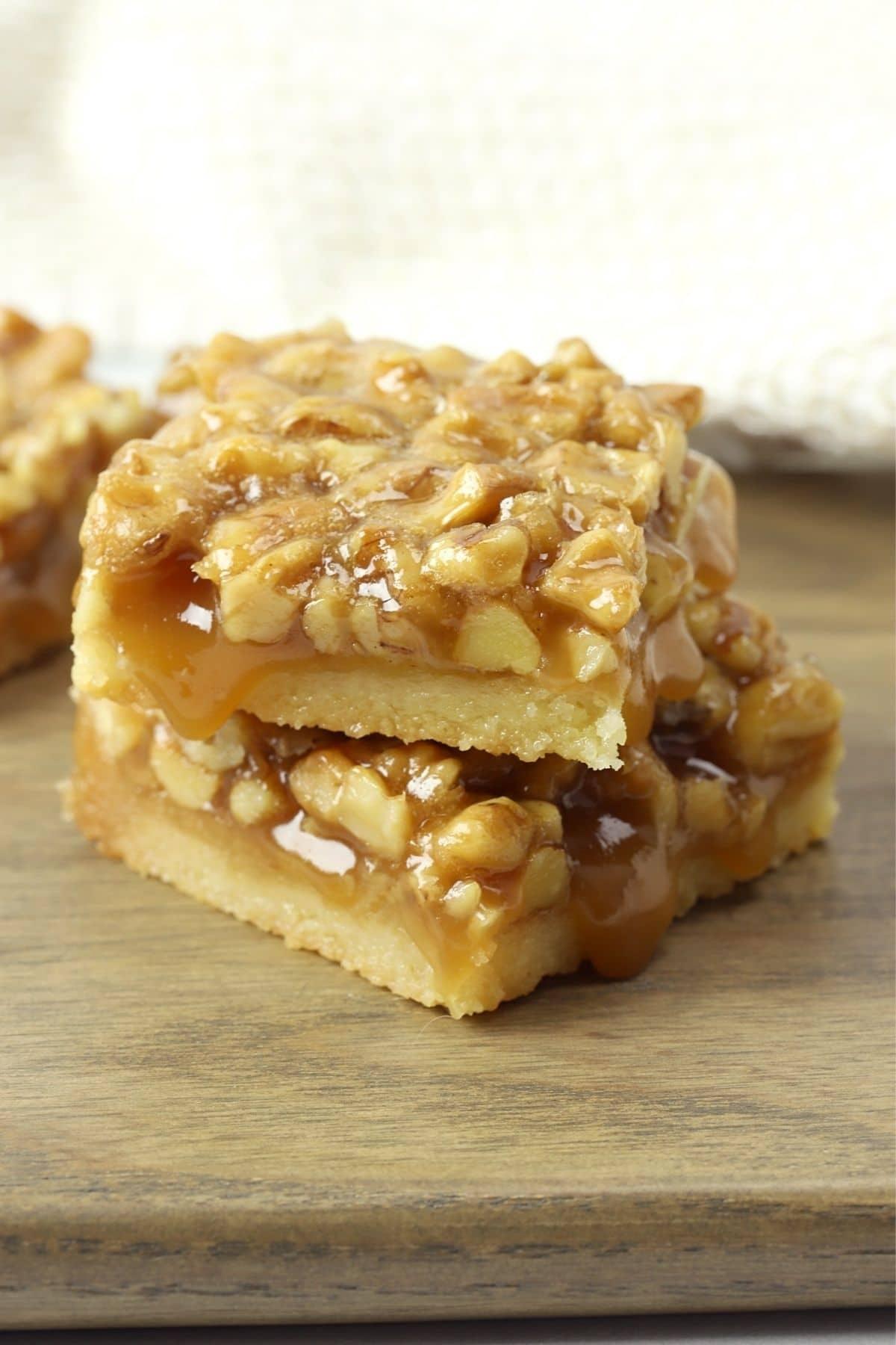 Stack of walnut honey bars on cutting board