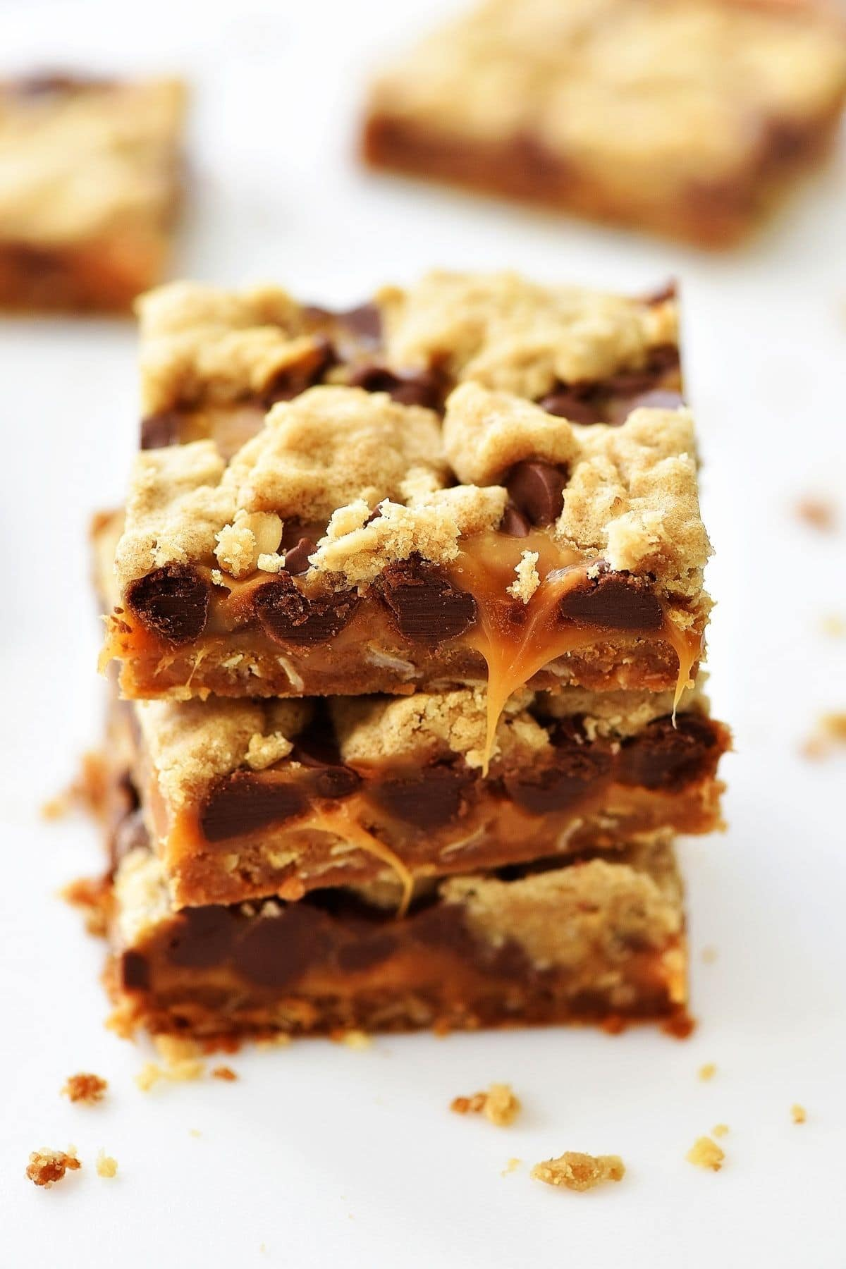 Cookie bar with caramel in center on white table