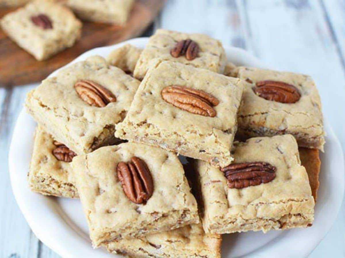 White plate stacked with chewy pecan bars