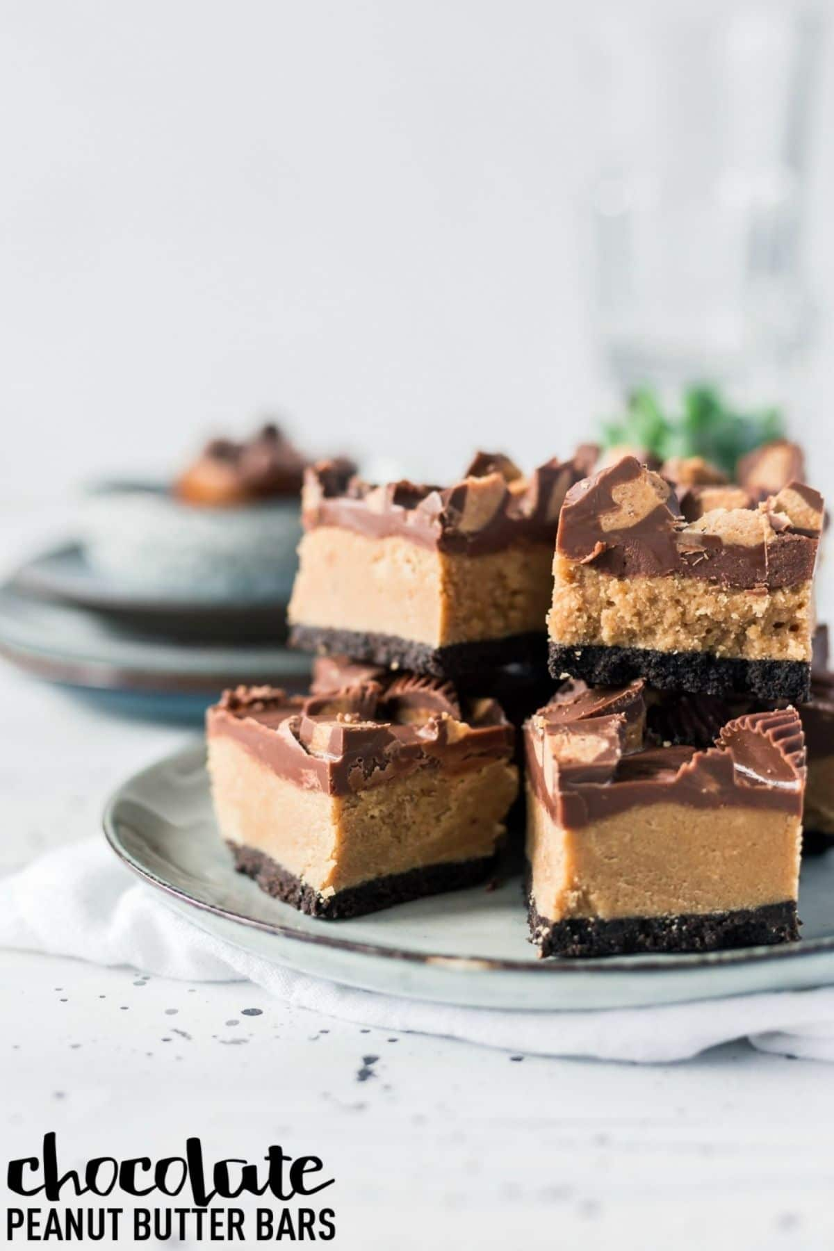 No bake peanut butter cup bars on blue plate