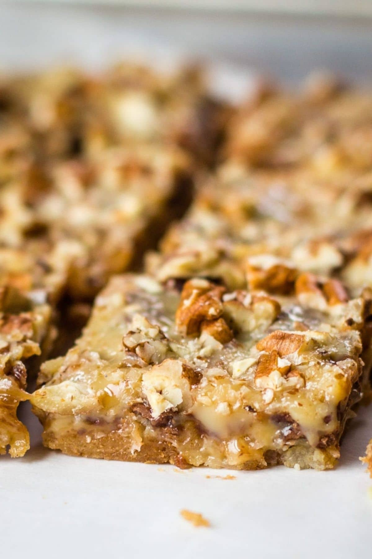 Close up of walnut toffee bars on plate