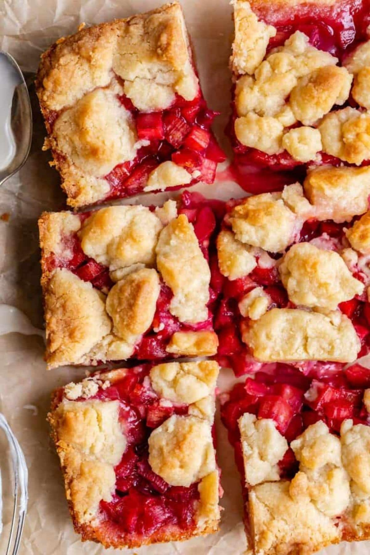 Rhubarb bars with shortbread topping cut on board