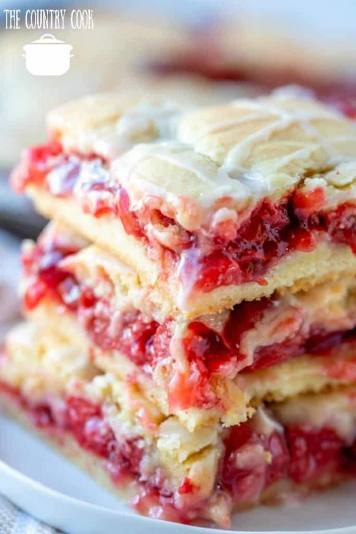 Stack of cherry pie bars on blue plate