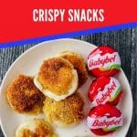 Cheese rounds on white plate with red banner that says babybel cheese crispy snacks