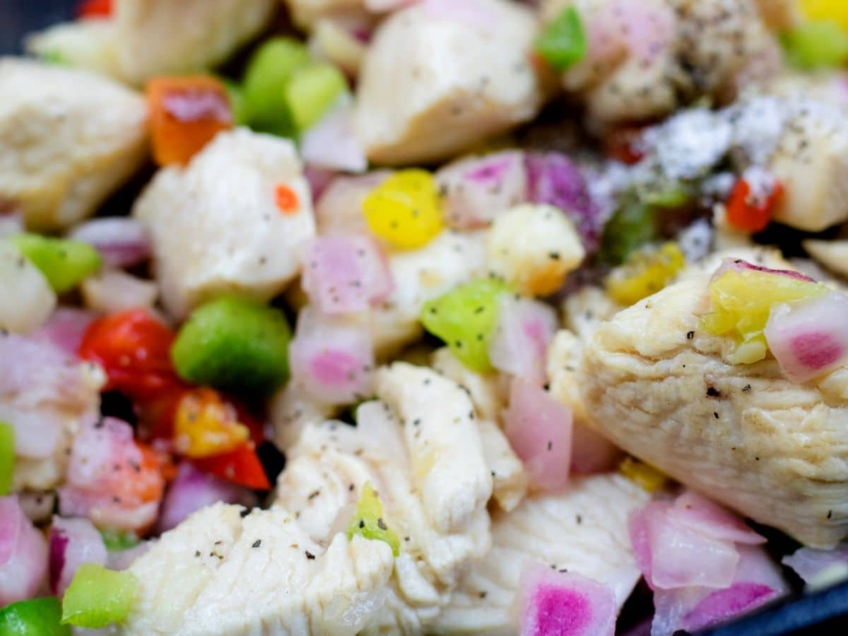 Chicken and vegetables in skillet