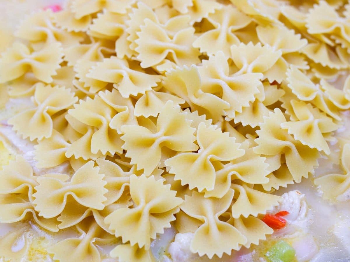 Adding pasta to skillet