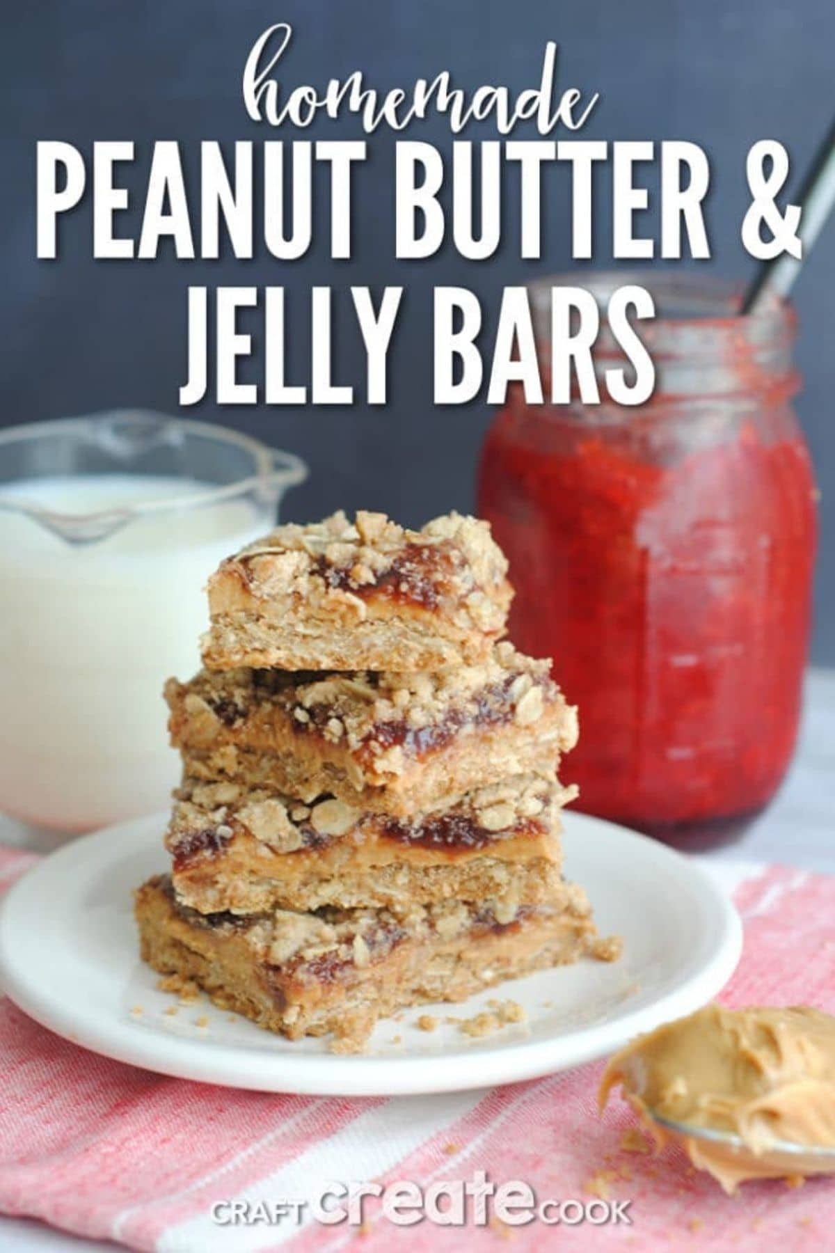 Peanut butter & jelly bars stacked on white plate