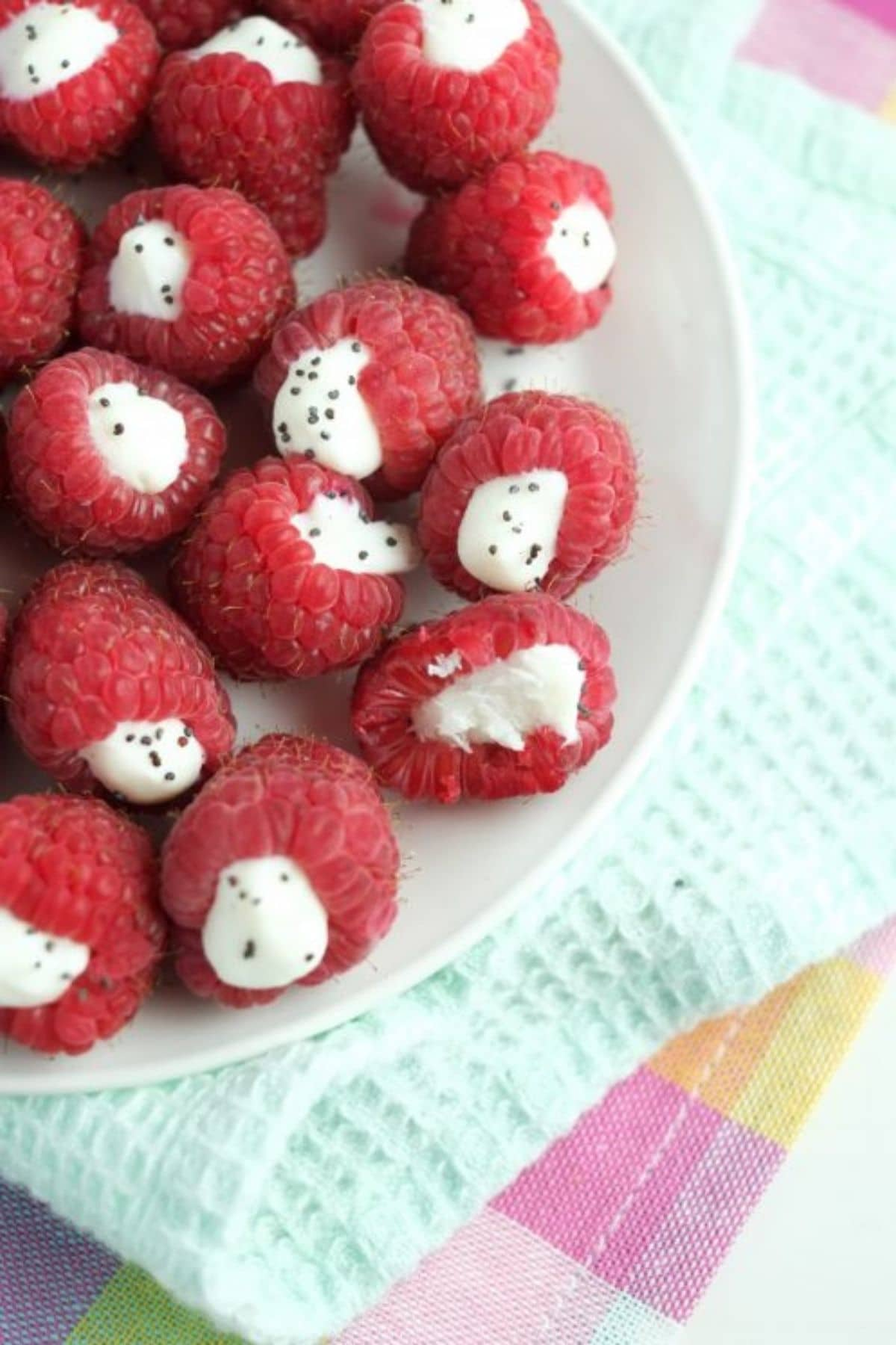 Raspberries with white stuffing on white plate