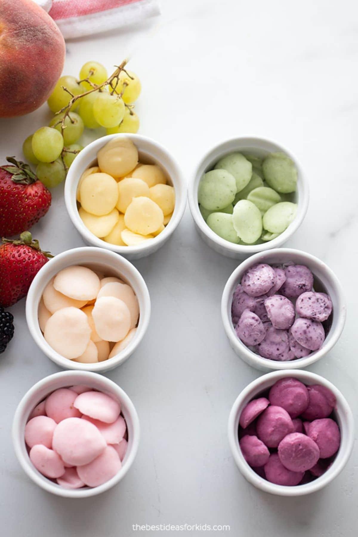 White bowls filled with pastel yogurt bites