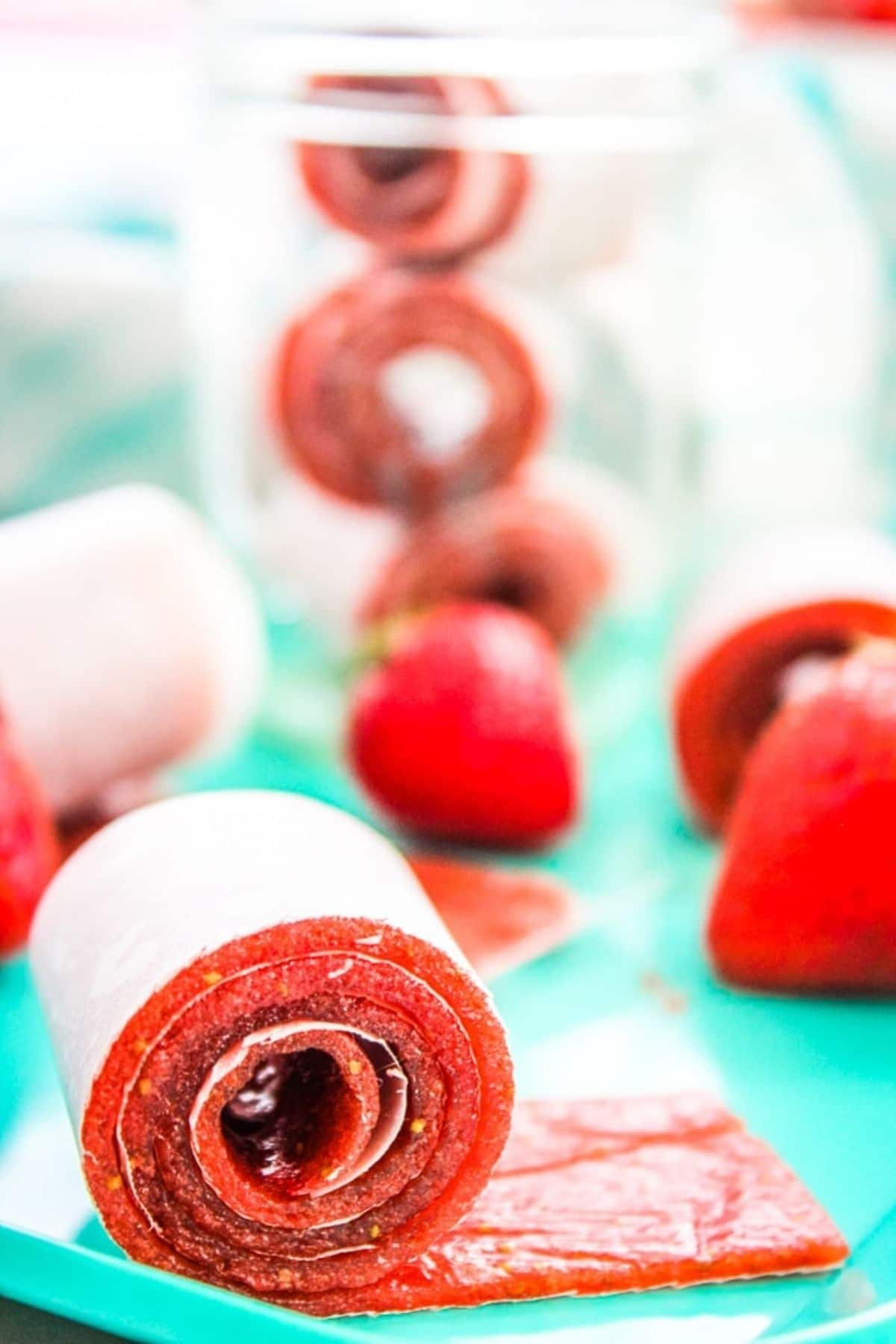 Homemade fruit roll ups on teal table